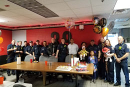 The family of baby Lauryn reached out to the firefighters from Station 39 in North Point who helped deliver her to include them in the birthday celebration. (Courtesy Fairfax County Fire and Rescue)