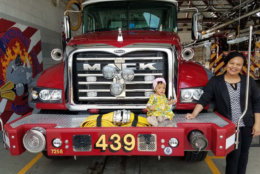 Lauryn and her mom got to pose on a fire truck. (Courtesy Fairfax County Fire and Rescue)