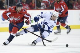 Washington Capitals left wing Jakub Vrana (13), of the Czech Republic, works for the puck against Tampa Bay Lightning left wing Ondrej Palat (18), of the Czech Republic, during the second period of an NHL hockey game Wednesday, March 20, 2019, in Washington. (AP Photo/Nick Wass)