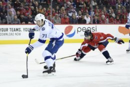 Tampa Bay Lightning center Anthony Cirelli (71) shoots next to Washington Capitals defenseman Michal Kempny (6), of the Czech Republic, during the first period of an NHL hockey game Wednesday, March 20, 2019, in Washington. (AP Photo/Nick Wass)