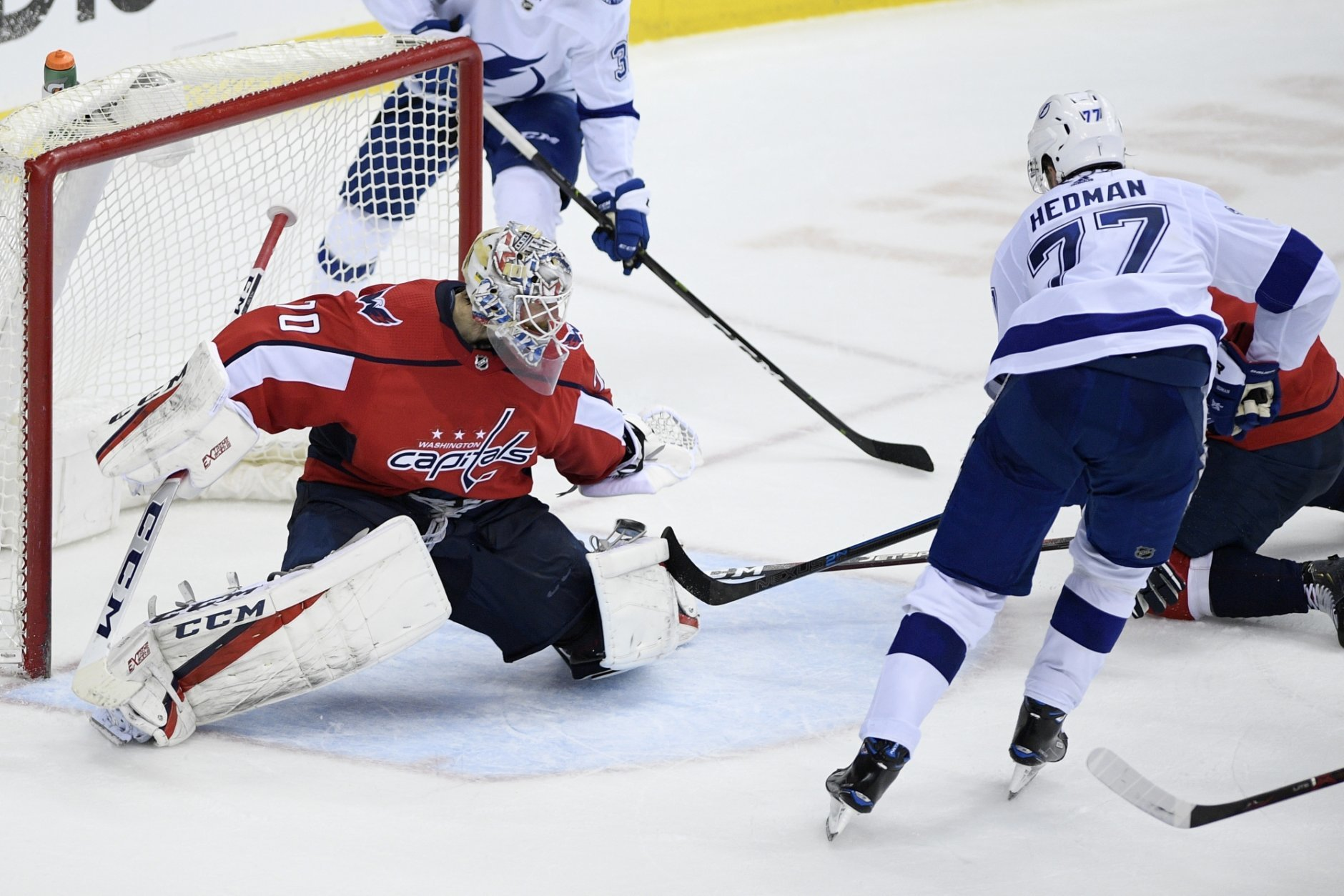 Tampa Bay Lightning defenseman Victor Hedman (77), of Sweden, scores in overtime against against Washington Capitals goaltender Braden Holtby (70) during an NHL hockey game Wednesday, March 20, 2019, in Washington. The Lightning won 5-4. (AP Photo/Nick Wass)