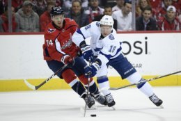 Tampa Bay Lightning left wing Ondrej Palat (18), of the Czech Republic, skates with the puck against Washington Capitals defenseman John Carlson (74) during the first period of an NHL hockey game Wednesday, March 20, 2019, in Washington. (AP Photo/Nick Wass)