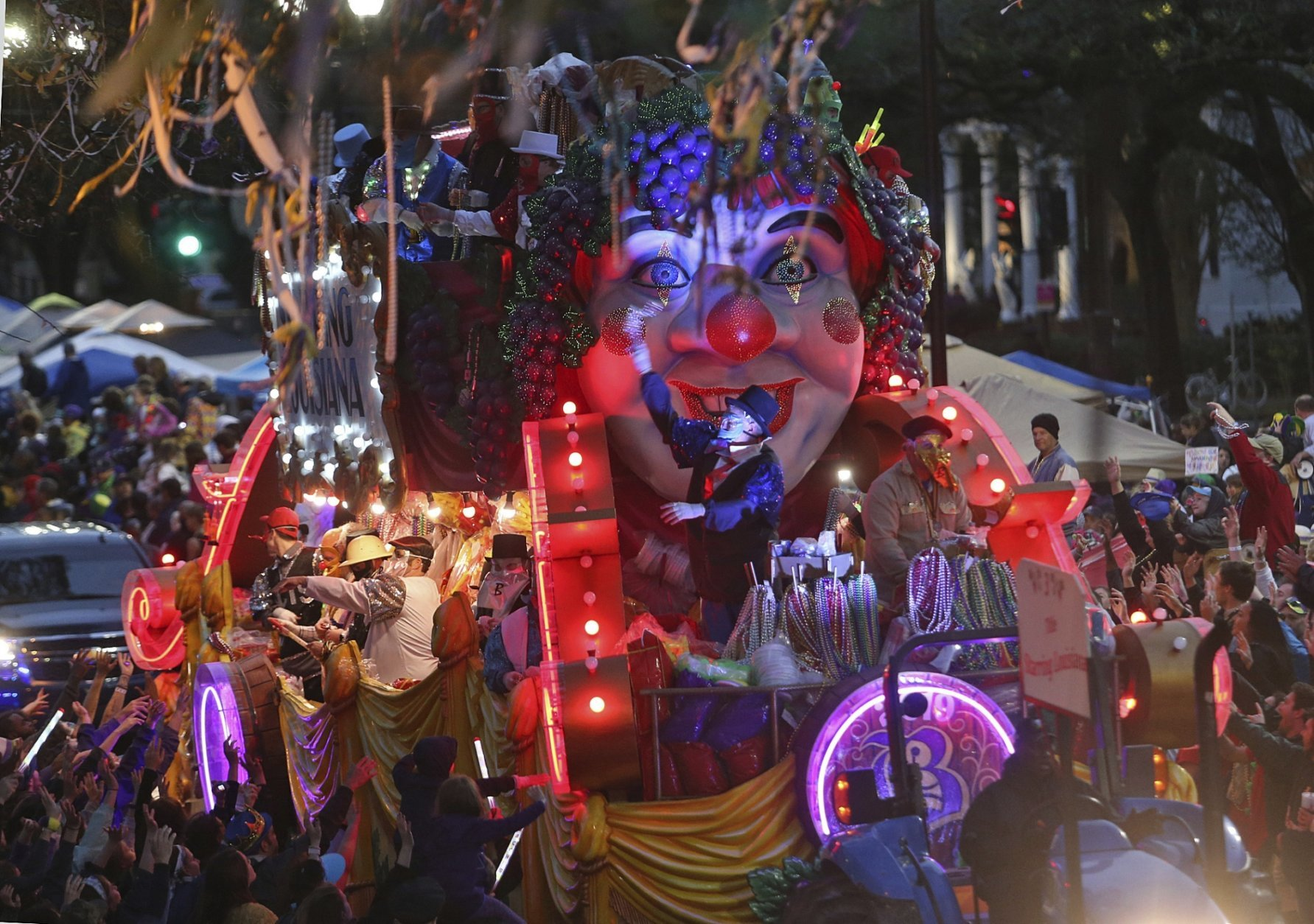 "The Title Float rolls down Napoleon Avenue as the 1,600 men of Bacchus present their 32-float Mardi Gras parade entitled ""Starring Louisiana"" on the Uptown route in New Orleans on Sunday, March 3, 2019. (Michael DeMocker/The Times-Picayune via AP)"