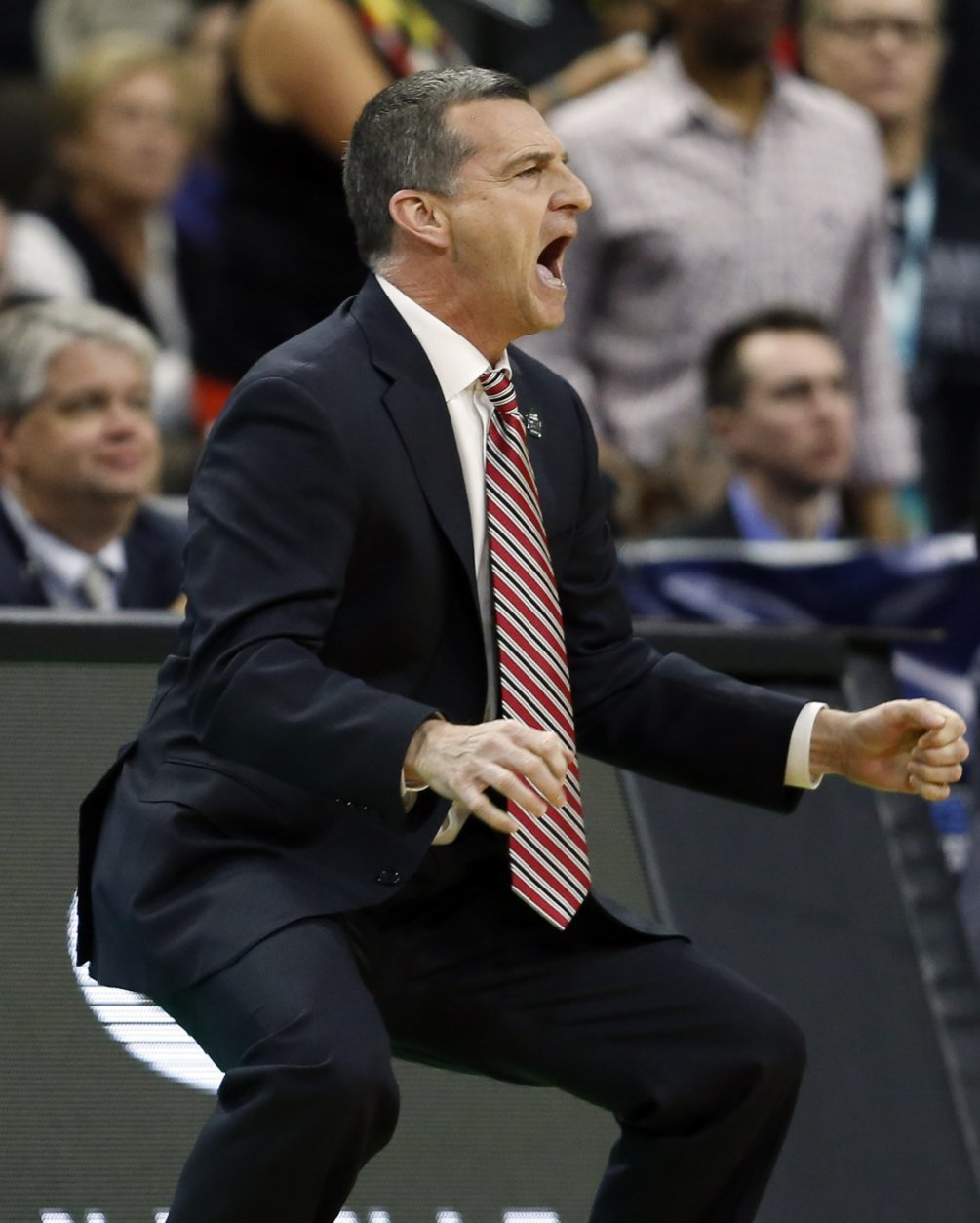 Maryland head coach Mark Turgeon reacts as he watches his team on the court against Belmont during the first half of a first round men's college basketball game in the NCAA Tournament in Jacksonville, Fla., Thursday, March 21, 2019. (AP Photo/Stephen B. Morton)