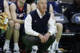 Belmont head coach Rick Boyd watches his team on the court during the first half of a first round men's college basketball game against Maryland in the NCAA Tournament in Jacksonville, Fla., Thursday, March 21, 2019. (AP Photo/Stephen B. Morton)