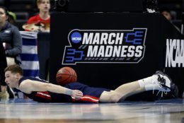 Belmont 's Dylan Windler lies on the floor after diving for the ball during the first half of a first round men's college basketball game against Maryland in the NCAA Tournament in Jacksonville, Fla., Thursday, March 21, 2019. (AP Photo/Stephen B. Morton)