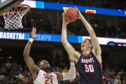 Belmont 's Seth Adelsperger (50) goes up over Maryland 's Bruno Fernando (23) to shoot during the second half of the first round men's college basketball game in the NCAA Tournament in Jacksonville, Fla., Thursday, March 21, 2019. (AP Photo/Stephen B. Morton)