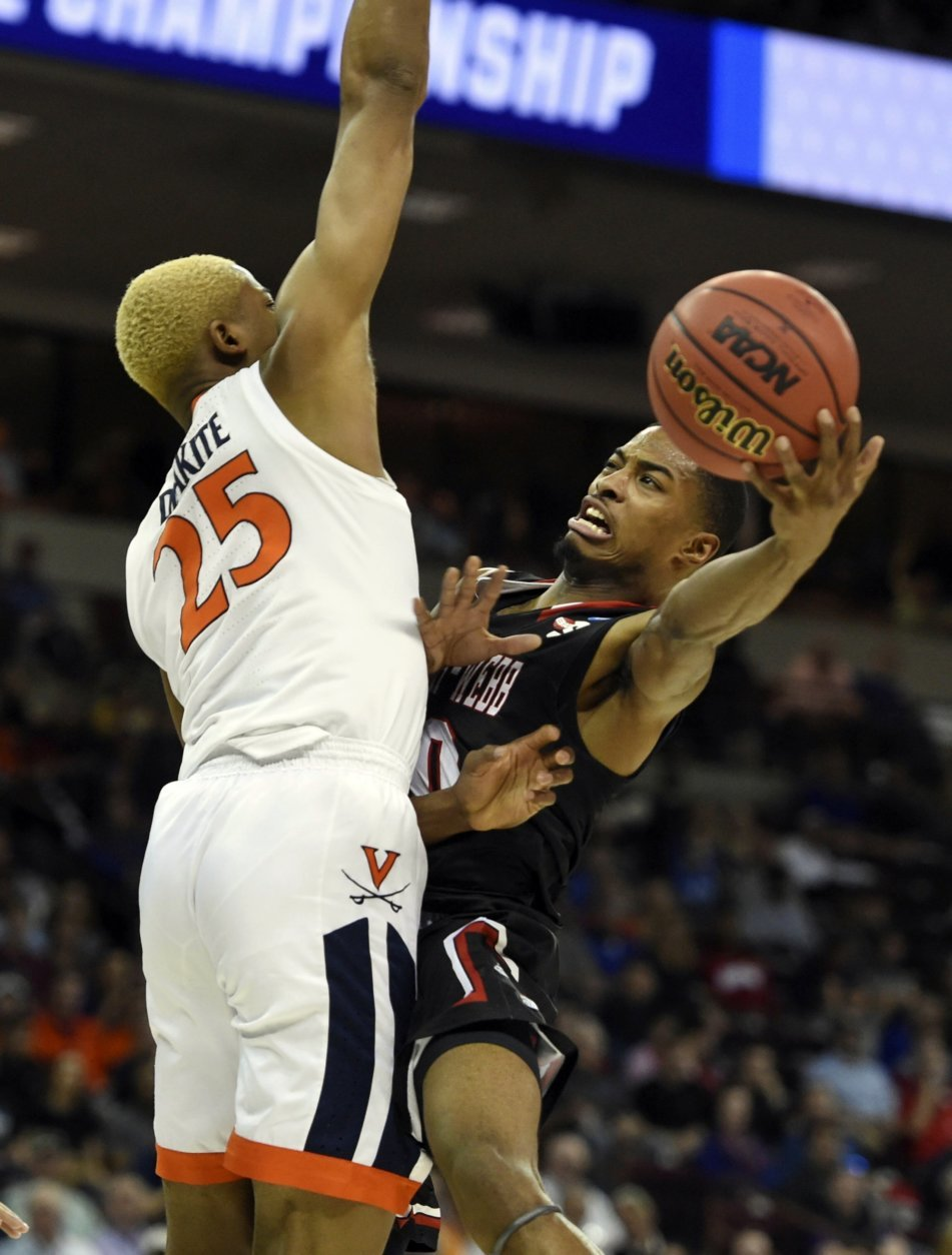Gardner-Webb's Nate Johnson, right, shoots around Virginia's DJ Laster (25) during a first-round game in the NCAA men's college basketball tournament in Columbia, S.C., Friday, March 22, 2019. (AP Photo/Richard Shiro)