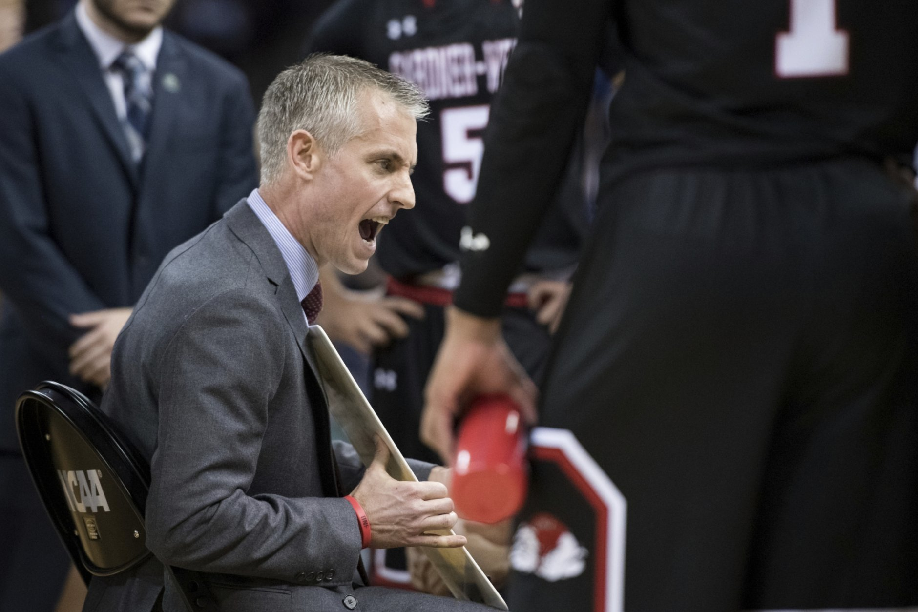 Gardner-Webb head coach Tim Craft talks with his team during a timeout against Virginia in a first-round game in the NCAA men's college basketball tournament Friday, March 22, 2019, in Columbia, S.C. (AP Photo/Sean Rayford)