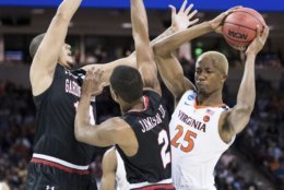Virginia forward Mamadi Diakite (25) attempts a move against Gardner-Webb forward Eric Jamison Jr. (2) and Brandon Miller, left, during a first-round game in the NCAA men's college basketball tournament Friday, March 22, 2019, in Columbia, S.C. (AP Photo/Sean Rayford)