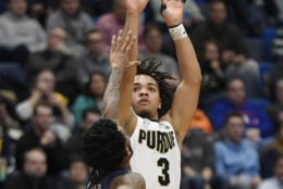 Purdue's Carsen Edwards shoots over Old Dominion's Ahmad Caver during the second half of a first round men's college basketball game against Old Dominion in the NCAA tournament, Thursday, March 21, 2019, in Hartford, Conn. (AP Photo/Jessica Hill)