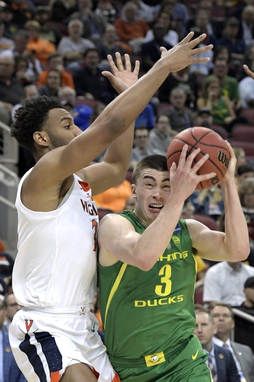 Oregon's Payton Pritchard (3) drives against Virginia's Braxton Key, left, during the first half of a men's NCAA Tournament college basketball South Regional semifinal game, Thursday, March 28, 2019, in Louisville, Ky. (AP Photo/Timothy D. Easley)