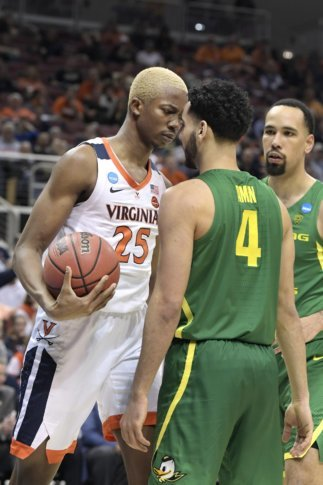 cheaper 7202d 5a270 Virginia s Mamadi Diakite (25) and Oregon s Ehab Amin (4) face off during  the second half of a men s NCAA Tournament college basketball South Regional  ...
