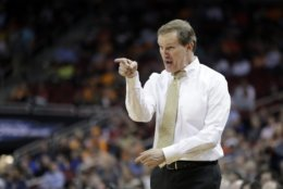 Oregon head coach Dana Altman reacts to a call during the first half of a men's NCAA Tournament college basketball South Regional semifinal game against Virginia, Thursday, March 28, 2019, in Louisville, Ky. (AP Photo/Michael Conroy)