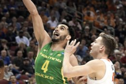 Oregon's Ehab Amin (4) drives past Virginia's Kyle Guy during the first half of a men's NCAA Tournament college basketball South Regional semifinal game, Thursday, March 28, 2019, in Louisville, Ky. (AP Photo/Timothy D. Easley)