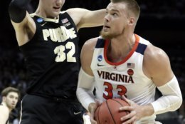 Virginia's Jack Salt (33) goes to the basket against Purdue's Matt Haarms (32) during the first half of the men's NCAA Tournament college basketball South Regional final game, Saturday, March 30, 2019, in Louisville, Ky. (AP Photo/Michael Conroy)