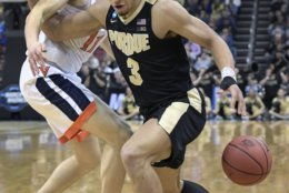 Purdue's Carsen Edwards (3) is defended by Virginia's Ty Jerome (11) during the first half of the men's NCAA Tournament college basketball South Regional final game, Saturday, March 30, 2019, in Louisville, Ky. (AP Photo/Timothy D. Easley)