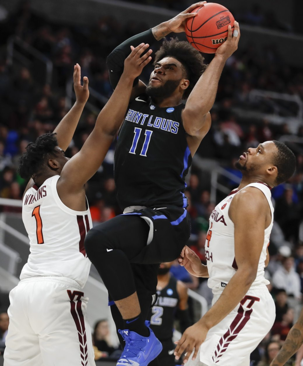 Saint Louis forward Hasahn French, middle, shoots between Virginia Tech guard Isaiah Wilkins, left, and forward P.J. Horne during the first half of a first-round game in the NCAA men's college basketball tournament Friday, March 22, 2019, in San Jose, Calif. (AP Photo/Ben Margot)