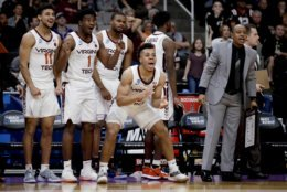 Virginia Tech players cheers during the first half of a first-round game against Saint Louis in the NCAA men's college basketball tournament Friday, March 22, 2019, in San Jose, Calif. (AP Photo/Ben Margot)