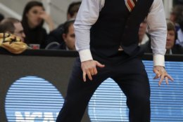 Virginia Tech coach Buzz Williams yells during the first half of the team's first-round game against Saint Louis in the NCAA men's college basketball tournament Friday, March 22, 2019, in San Jose, Calif. (AP Photo/Ben Margot)