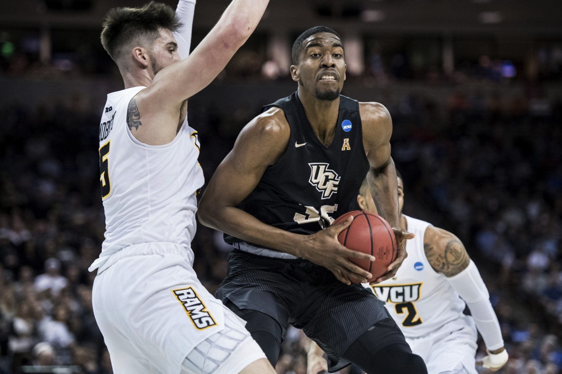 Central Florida forward Collin Smith (35) drives to the basket against VCU forward Sean Mobley (5) during the first half of a first-round game in the NCAA men's college basketball tournament Friday, March 22, 2019, in Columbia, S.C. (AP Photo/Sean Rayford)