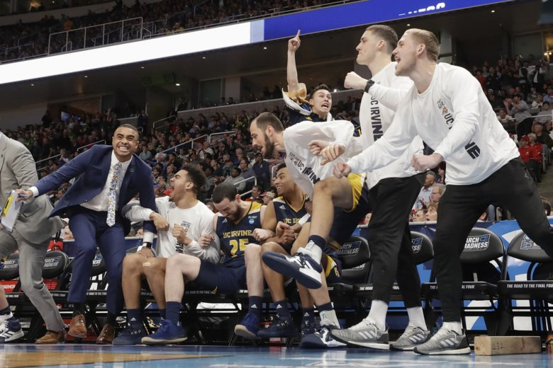 967ae5c6c83 UC Irvine players and coaches celebrate during the second half of a first  round men s college basketball game against Kansas State in the NCAA.