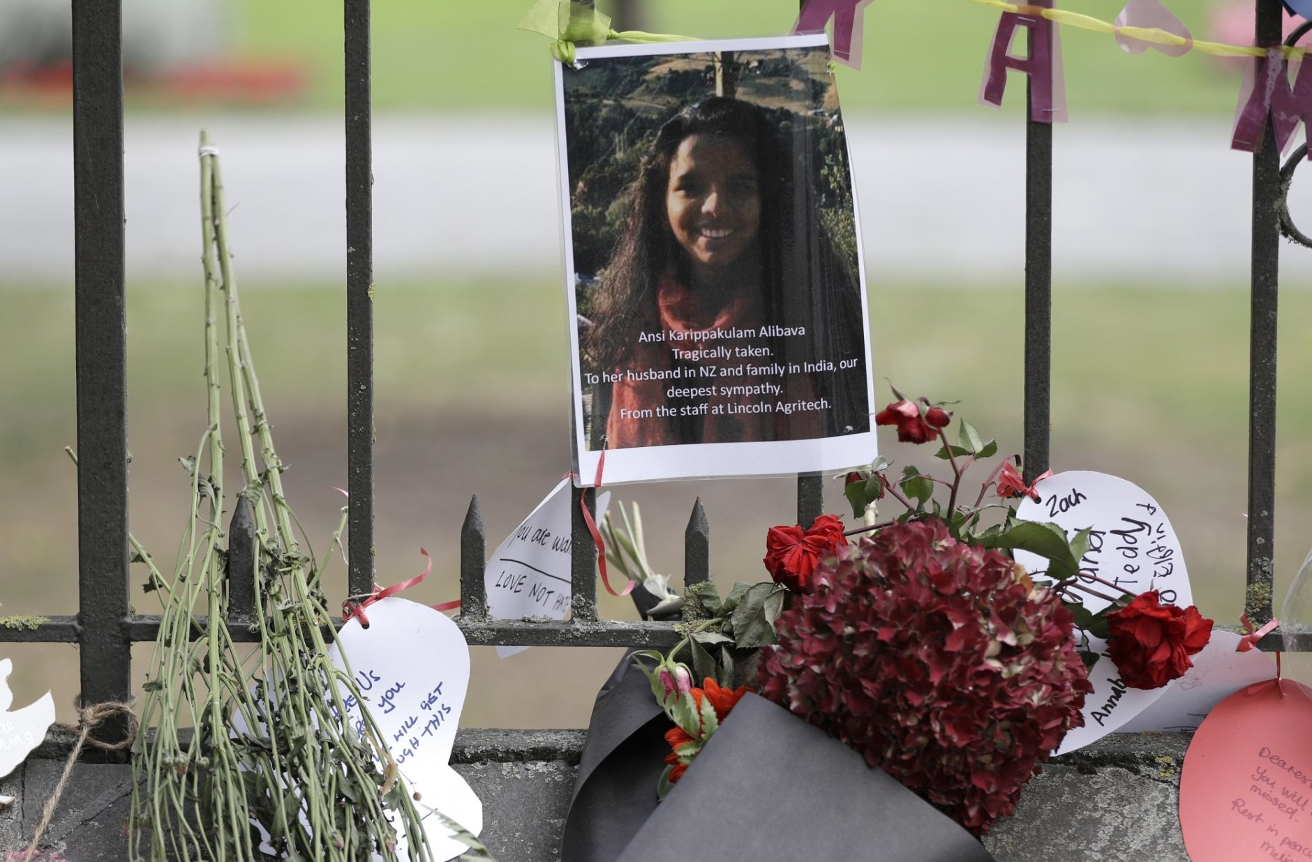 A tribute of a victim of mosque shooting, Ansi Alibava, hangs on a wall at the Botanical Gardens in Christchurch, New Zealand, Thursday, March 21, 2019. Thousands of people were expected to come together for an emotional Friday prayer service led by the imam of one of the two New Zealand mosques where 50 worshippers were killed in a white supremacist attack on Friday March 15. (AP Photo/Mark Baker)
