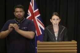 In this image made from video, New Zealand's Prime Minister Jacinda Ardern, right, speaks during a press conference in Wellington, Thursday, March 21, 2019. The New Zealand government is asking all owners of assault weapons or now-banned attachments to report them to the government in the next two days before turning them in. Ardern on Thursday announced that the government was immediately banning sales of what New Zealand calls military style semi-automatic rifles and high-capacity magazines like the weapons used in last Friday's attacks on two Christchurch mosques. (TVNZ via AP)
