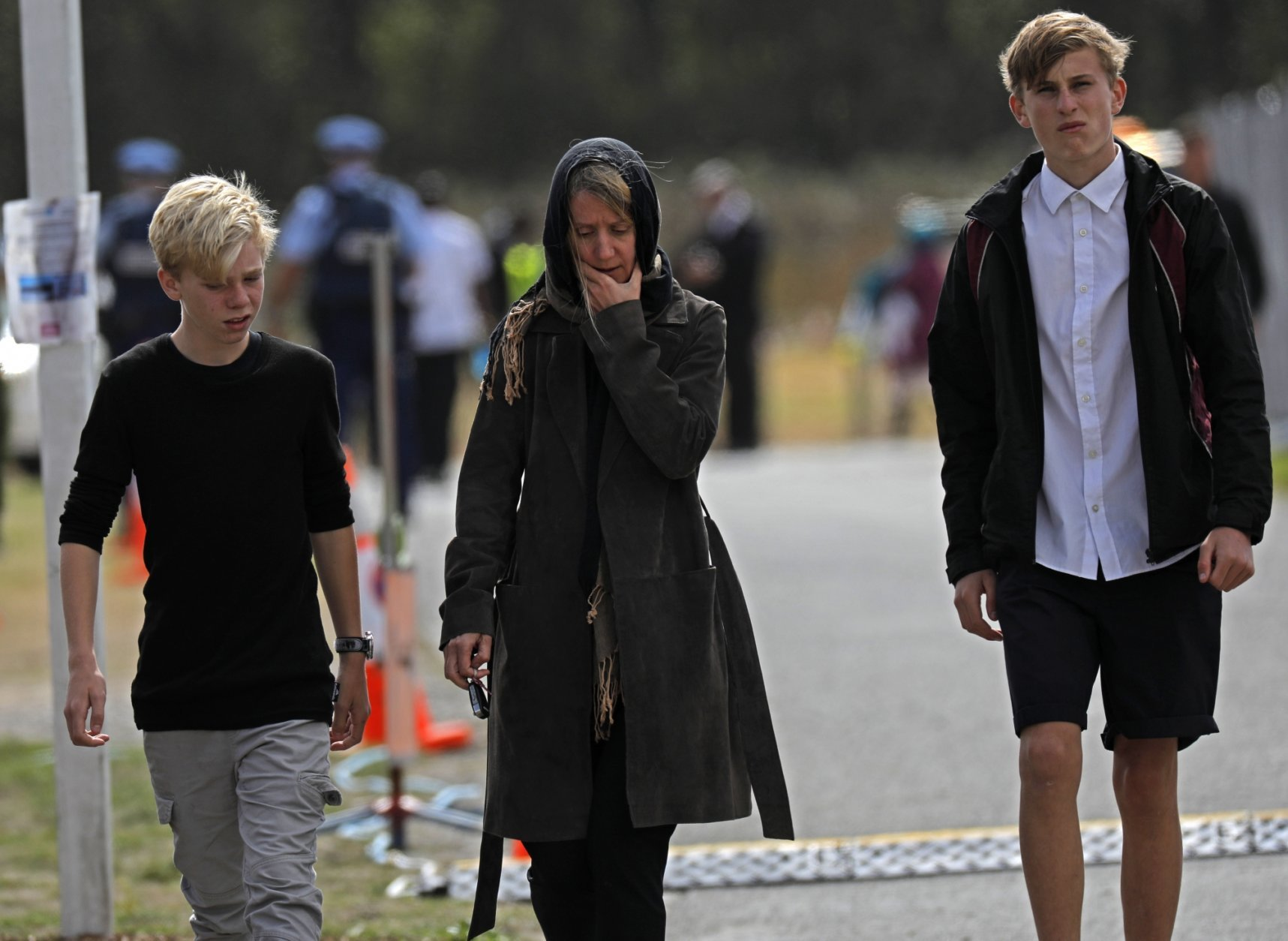 Mourners leave the cemetery after the burial service for a victim of the Friday March 15 mosque shootings at the Memorial Park Cemetery in Christchurch, New Zealand, Thursday, March 21, 2019. (AP Photo/Vincent Yu)