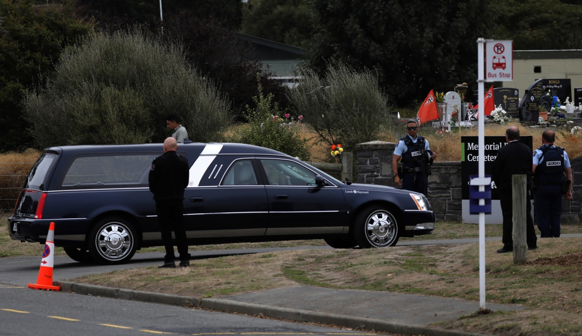 A hearse arrives with the body of a victim of the mosque shootings for burial at the Memorial Park Cemetery in Christchurch, New Zealand, Thursday, March 21, 2019. (AP Photo/Vincent Yu)