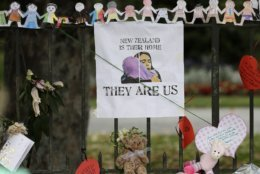 A poster featuring a drawing of Prime Minister Jacinda Ardern hangs on a wall at the Botanical Gardens in Christchurch, New Zealand, Thursday, March 21, 2019. Thousands of people were expected to come together for an emotional Friday prayer service led by the imam of one of the two New Zealand mosques where 50 worshippers were killed in a white supremacist attack on Friday March 15. (AP Photo/Mark Baker)