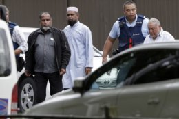 Police escort men from a mosque in central Christchurch, New Zealand, Friday, March 15, 2019. Multiple people were killed in mass shootings at two mosques full of people attending Friday prayers, as New Zealand police warned people to stay indoors as they tried to determine if more than one gunman was involved. (AP Photo/Mark Baker)