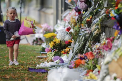Mourners pay tribute to New Zealand victims, await burials