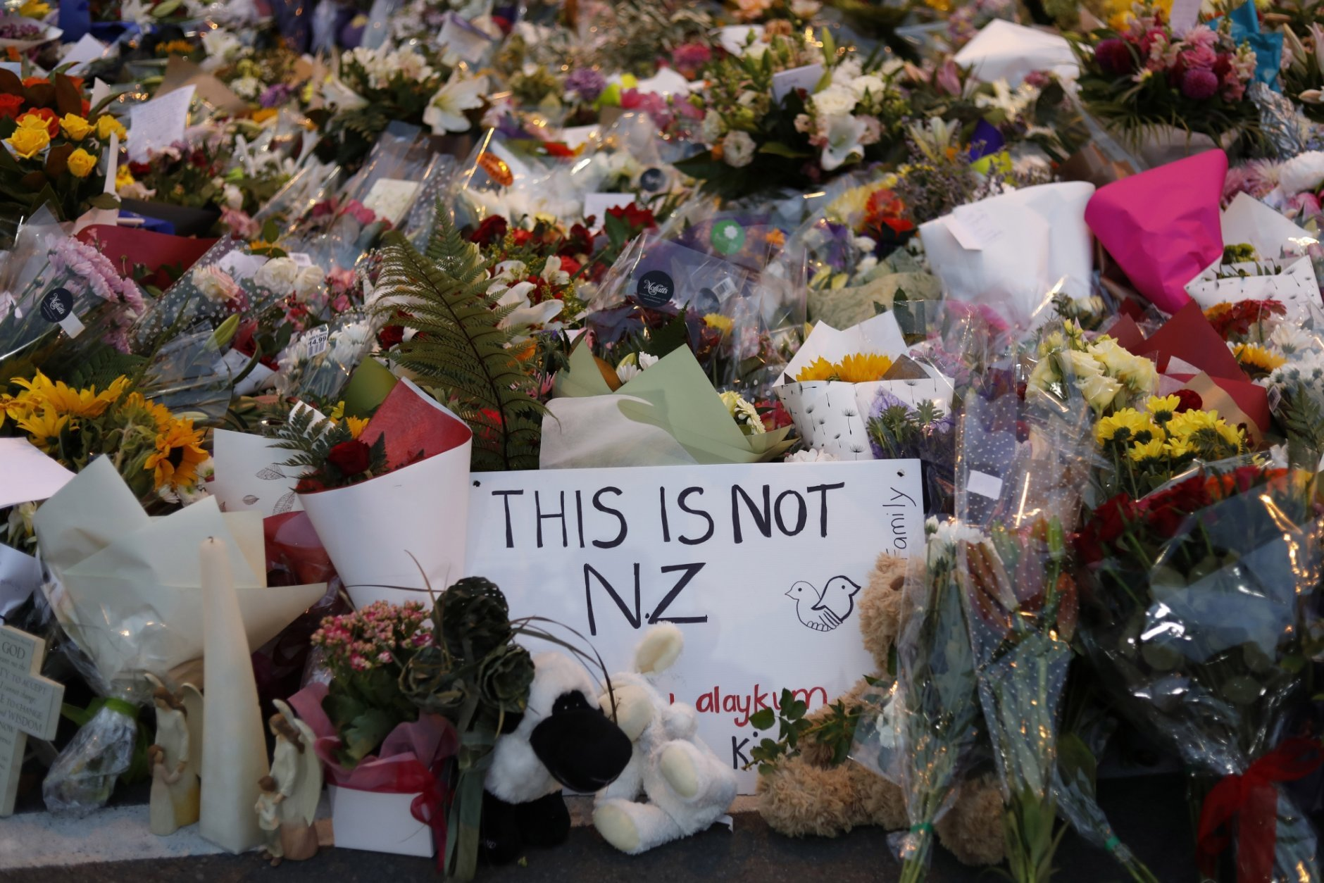 In this Saturday, March 16, 2019, file photo, flowers lay at a memorial near the Masjid Al Noor mosque for victims in last week's shooting in Christchurch, New Zealand. The leafy New Zealand city where a self-proclaimed racist fatally shot 50 people at mosques during Friday prayers is known for its picturesque meandering river and English heritage. For decades, the southern city of Christchurch also has been the center of the country's small but persistent white supremacist movement. (AP Photo/Vincent Yu, File)