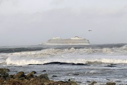 The cruise ship Viking Sky after it sent out a Mayday signal because of engine failure in windy conditions off the west coast of Norway, Saturday March 23, 2019.  The Viking Sky is forced to evacuate its 1,300 passengers. (Odd Roar Lange / NTB scanpix via AP)