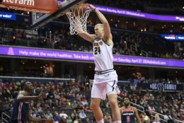 Denver Nuggets forward Mason Plumlee (24) dunks against Washington Wizards center Thomas Bryant, bottom left, and guard Chasson Randle (9) during the first half of an NBA basketball game Thursday, March 21, 2019, in Washington. (AP Photo/Nick Wass)