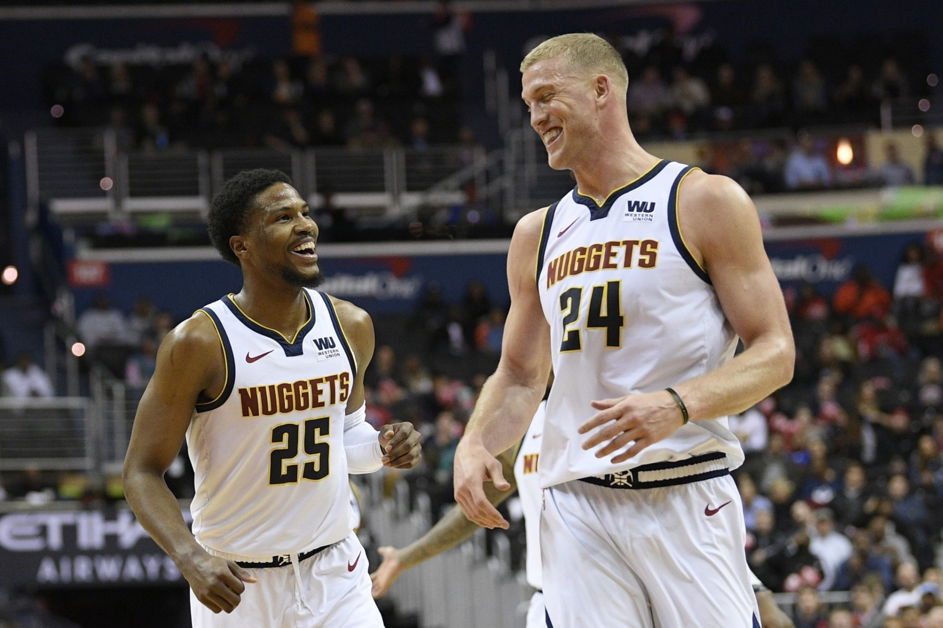 Denver Nuggets guard Malik Beasley (25) and Mason Plumlee (24) smile after Beasley made a 3-point basket during the second half of the team's NBA basketball game against the Washington Wizards, Thursday, March 21, 2019, in Washington. The Nuggets won 113-108. (AP Photo/Nick Wass)