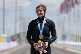 In this Wednesday, July 22, 2015 file photo, United States gold medalist Kelly Catlin poses after winning  the women's individual time trial cycling competition at the Pan Am Games in Milton, Ontario. Olympic track cyclist Kelly Catlin, who helped the U.S. women's pursuit team win the silver medal at the Rio de Janeiro Games in 2016, died Friday, March 8, 2019 at her home in California. She was 23. (AP Photo/Felipe Dana, File)