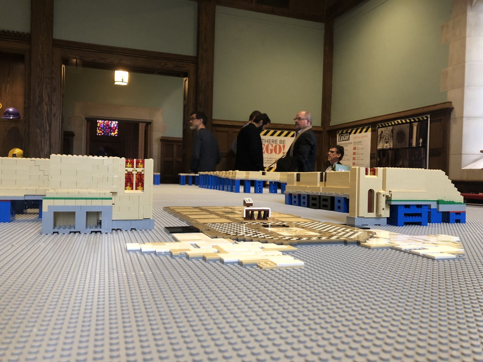 In the gift shop, visitors purchase bricks for $2 apiece and then are directed to a table in a room where the foundation of the 13-foot long cathedral sits. (WTOP/Mike Murillo)