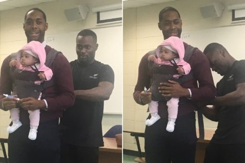 A student couldn't find a babysitter. So his professor held his infant girl in class so he could take notes