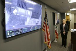 Sacramento County District Attorney Anne Marie Schubert displays a video from a Sacramento County Sheriff's helicopter in last year's fatal shooting of an unarmed black man, during a news conference in Sacramento, Calif., Saturday, March 2, 2019. Schubert said that Officers Terrance Mercadal and Jared Robinet did not break any laws when they shot Stephon Clark after the 22-year-old vandalism suspect ran from them into his grandparents' backyard last year. (AP Photo/Rich Pedroncelli)