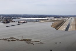 This March 17, 2019 photo released by the U.S. Air Force shows an aerial view of Offutt Air Force Base and the surrounding areas affected by flood waters in Neb. Surging unexpectedly strong and up to 7 feet high, the Missouri River floodwaters that poured on to much the Nebraska air base that houses the U.S. Strategic Command overwhelmed the frantic sandbagging by troops and their scramble to save sensitive equipment, munitions and aircraft. (Tech. Sgt. Rachelle Blake/The U.S. Air Force via AP)