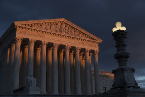 The Latest: High court wary of limiting partisan map drawing