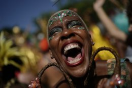 """A reveler in costume laughs during the """"Cordao do Boitata"""" street party in Rio de Janeiro, Brazil, Sunday, Feb. 24, 2019, one of the many parades before the official start of Carnival on March 1. (AP Photo/Leo Correa)"""