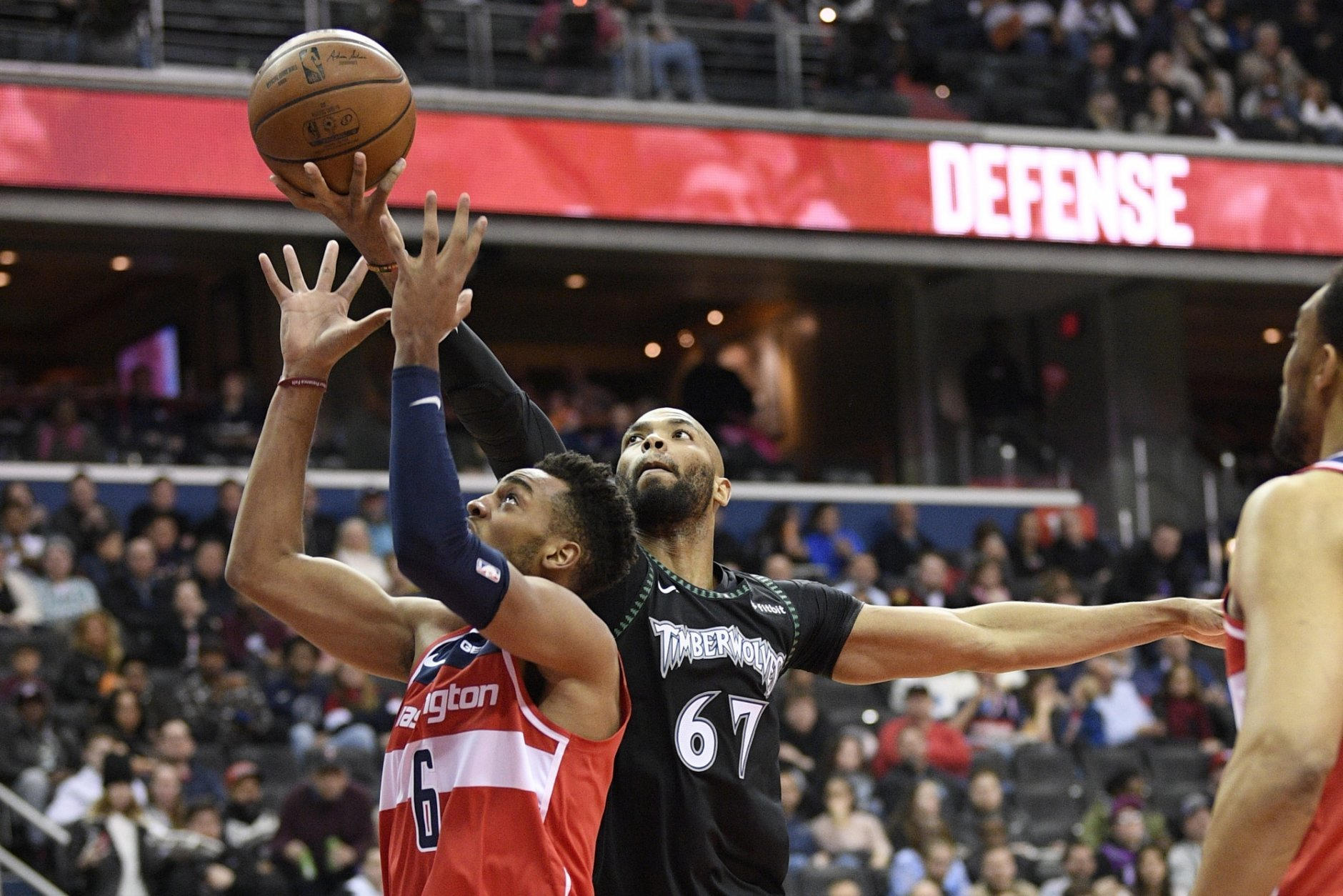 Minnesota Timberwolves forward Taj Gibson (67) battles for the ball against Washington Wizards forward Troy Brown Jr. (6) during the first half of an NBA basketball game, Sunday, March 3, 2019, in Washington. (AP Photo/Nick Wass)