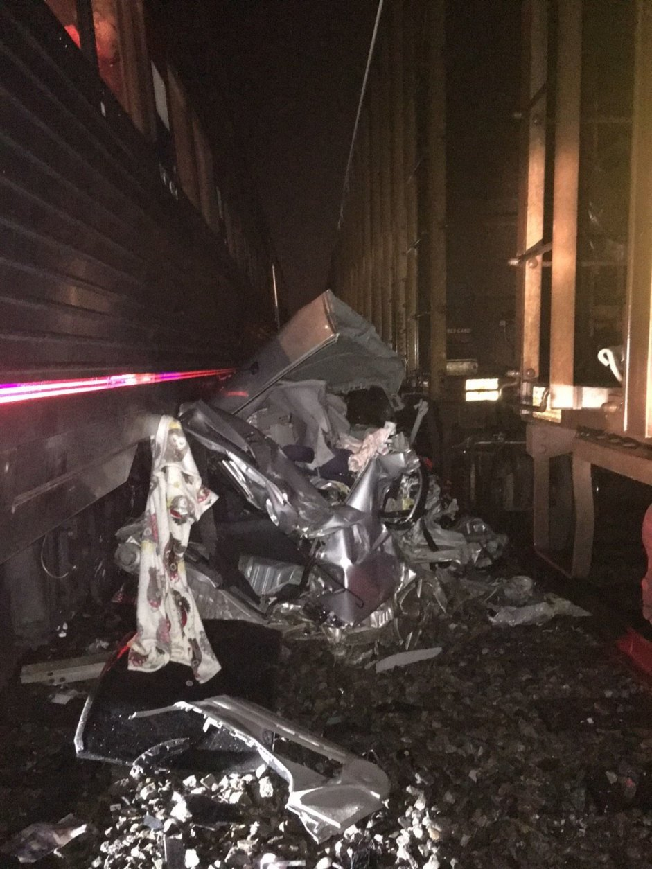 A Honda Civic was struck by two trains in Virginia on Sunday. The passengers were able to get out of the car before the trains hit. (Courtesy Virginia State Police)