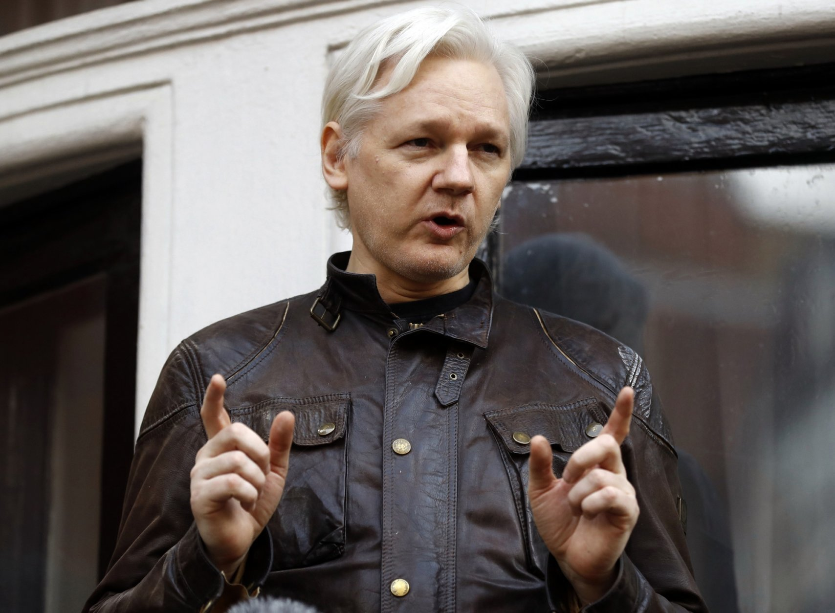 FILE - In this May 19, 2017 file photo, WikiLeaks founder Julian Assange gestures to supporters outside the Ecuadorian embassy in London, where he has been in self imposed exile since 2012.  (AP Photo/Frank Augstein, File)