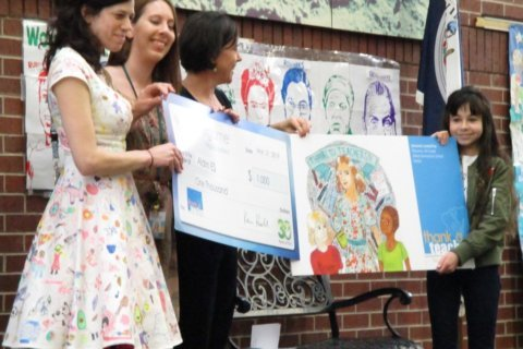 Virginia Lottery surprises Aldrin Elementary School student with prize for art contest