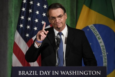 Brazil's far-right president visits CIA on friendly US tour