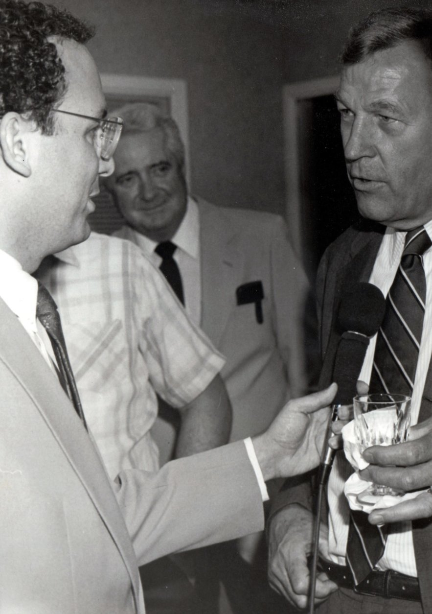 In this 1987 photo, Statter interviews NBC's Roger Mudd, who worked for WTOP before the 1969 switch to all-news. Hear how he almost took Jamie Bragg's on-air name in this audio tribute. (Courtesy Dave Statter)